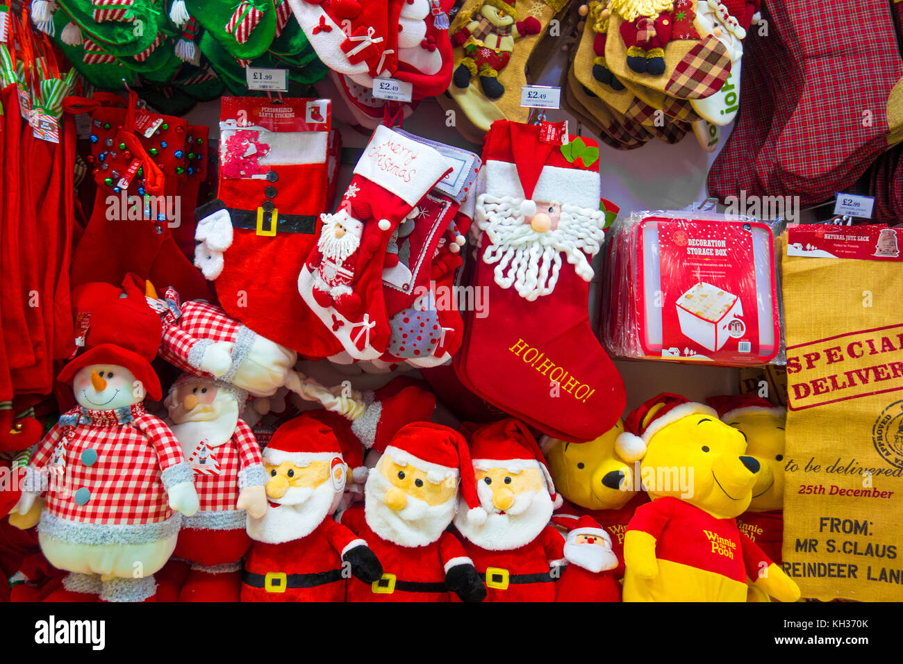 christmas gifts and decorations on sale in a shop - Stock Image
