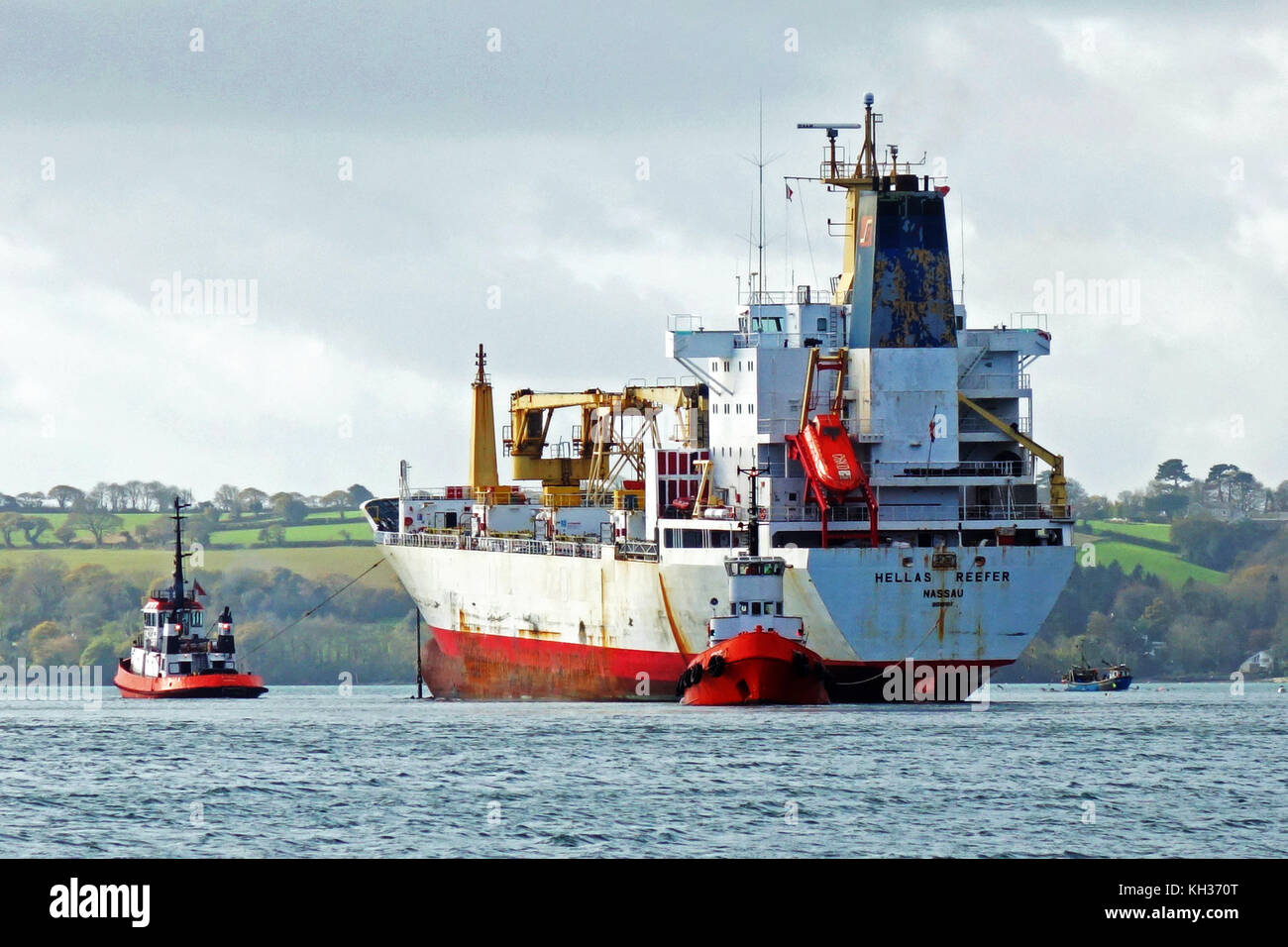 cargo ship in the river fal, cornwall, uk - Stock Image