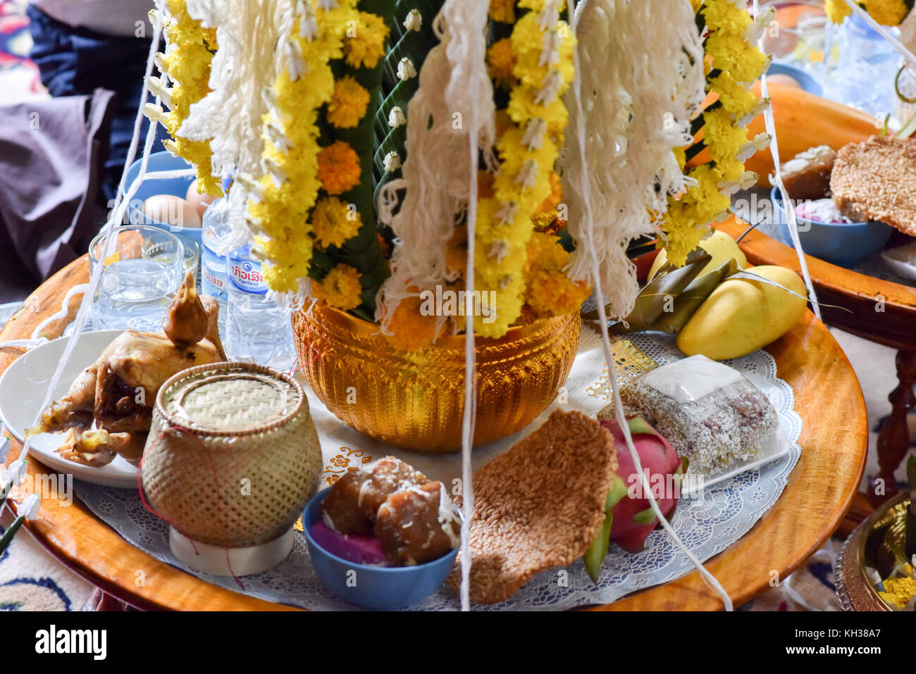 Offerings to the Gods , traditional Buddhist wedding Laos - Stock Image