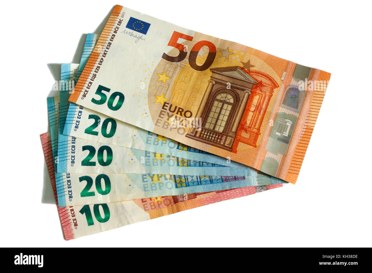 Euro currency notes in small denominations arranged in fan shape. Cutout on white background. Concept photo to illustrate - Stock Image