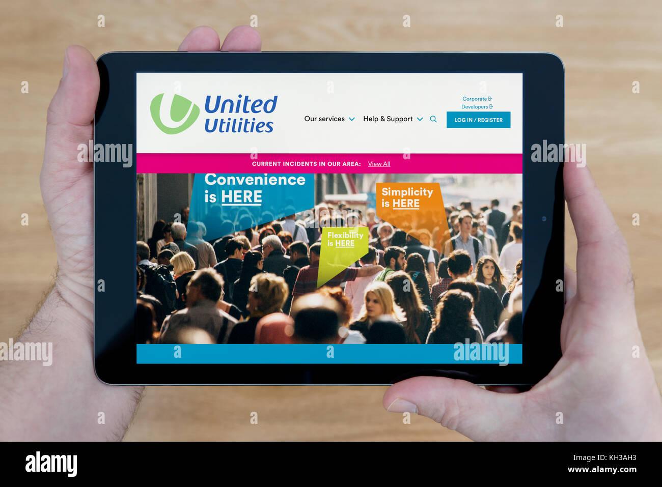 United utilities logo stock photos united utilities logo stock a man looks at the united utilities website on his ipad tablet device shot against voltagebd Gallery