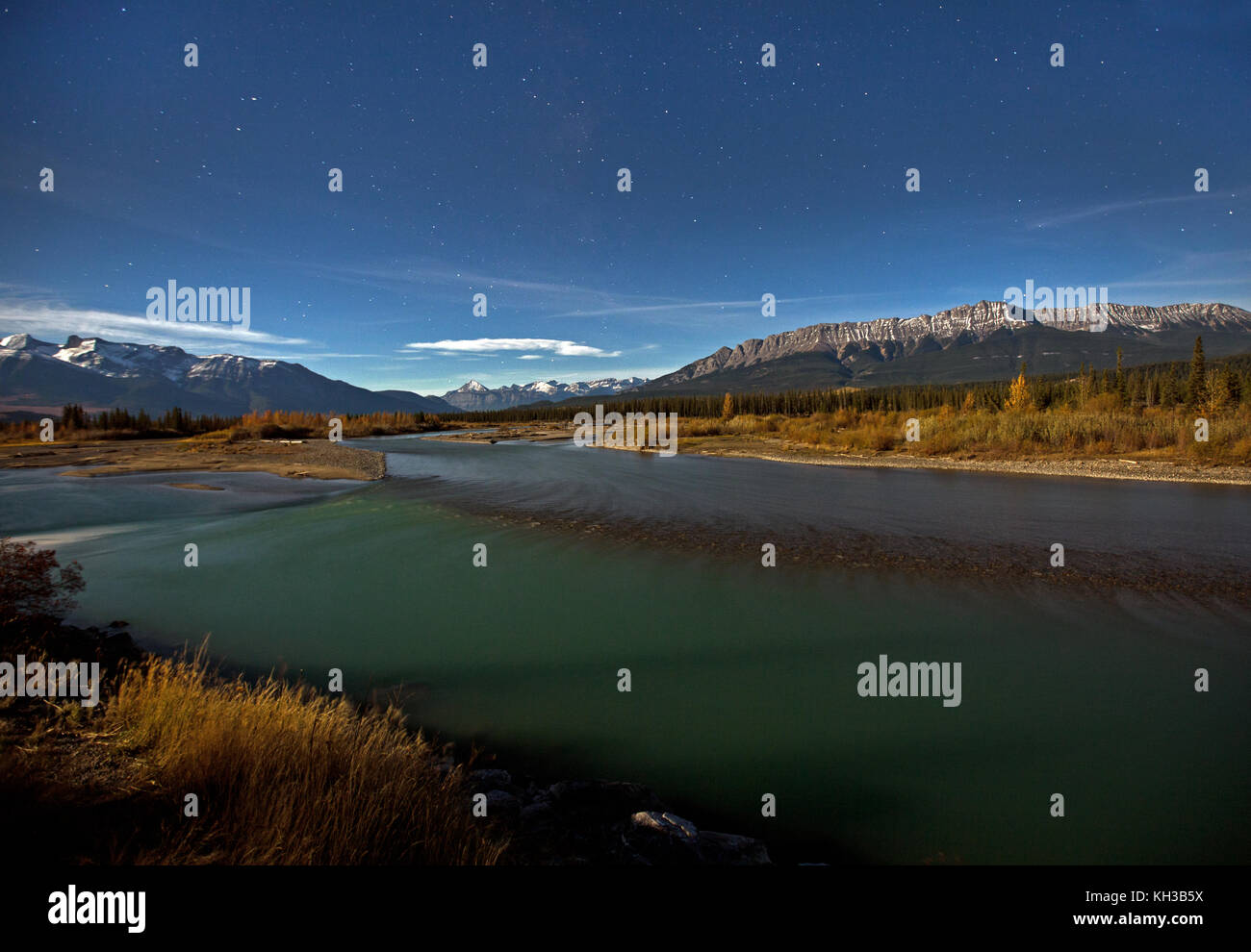 the athabasca river, with pyramid mountain in background, at night - Stock Image