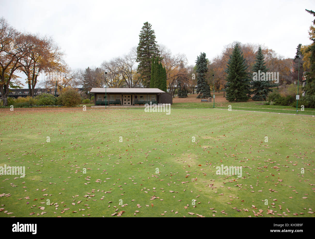 a green lawn bowling area in the park - Stock Image