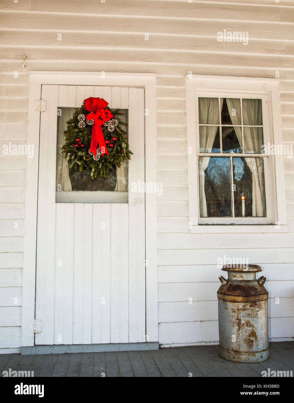 Christmas Wreath On An Old Farmhouse Front Porch Door And A Vintage