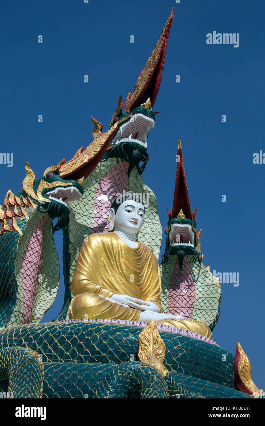 A Buddha Image protected by Nagas (mythical dragon-like creatures) near Monywa in Myanmar (Burma). - Stock Image