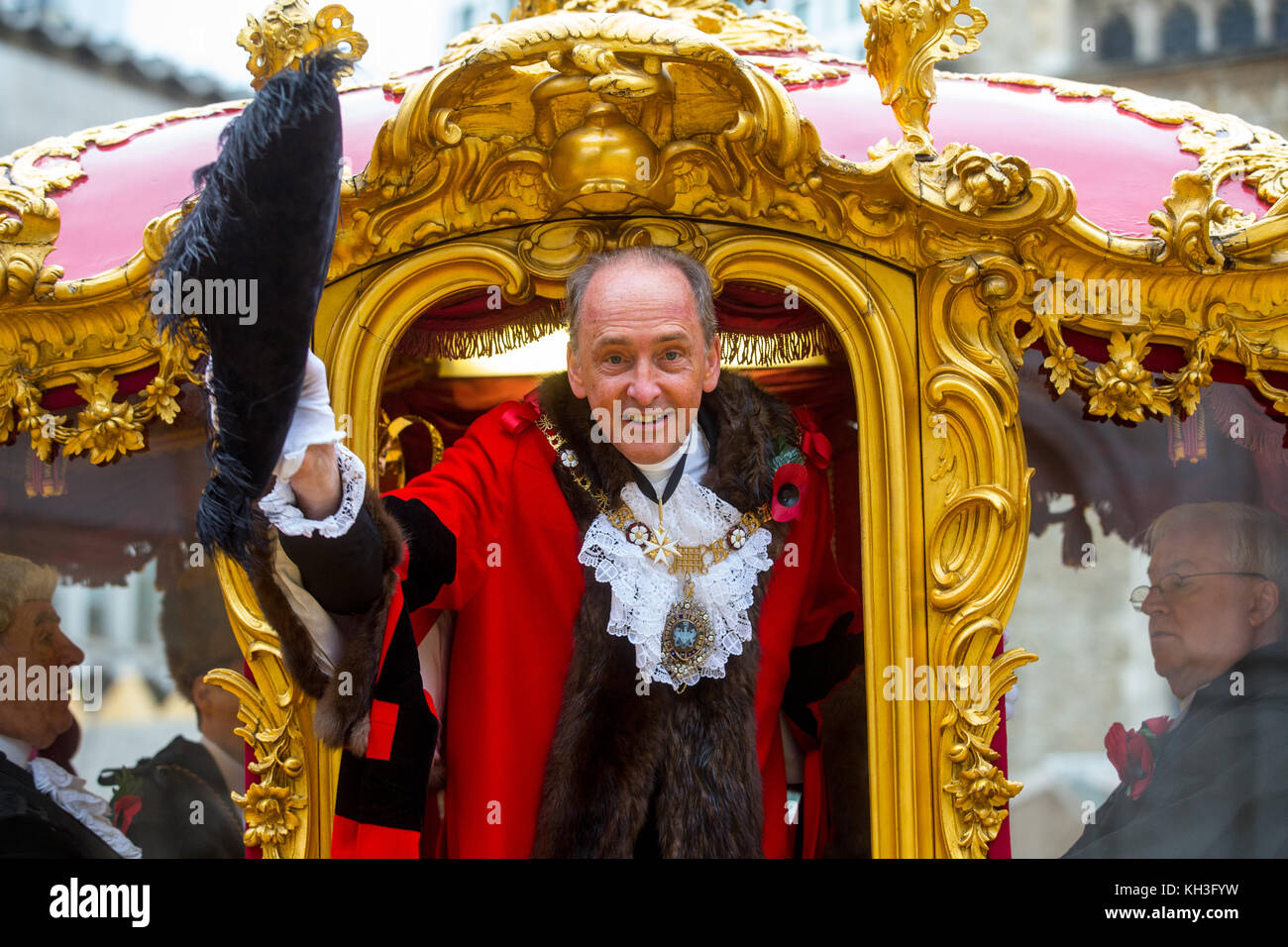 The New Lord Mayor of London, Charles Bowman, waves his tricorn hat from the Lord Mayor's gold carriage outside - Stock Image