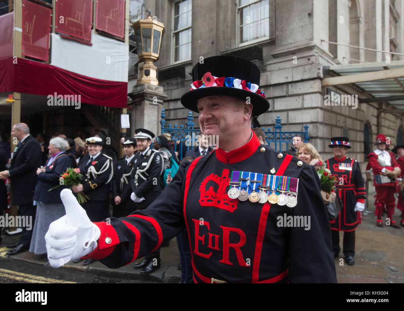 A Beefeater gives the thumbs up at the Lord Mayor's Show at the mansion House in the City of London. Charles - Stock Image
