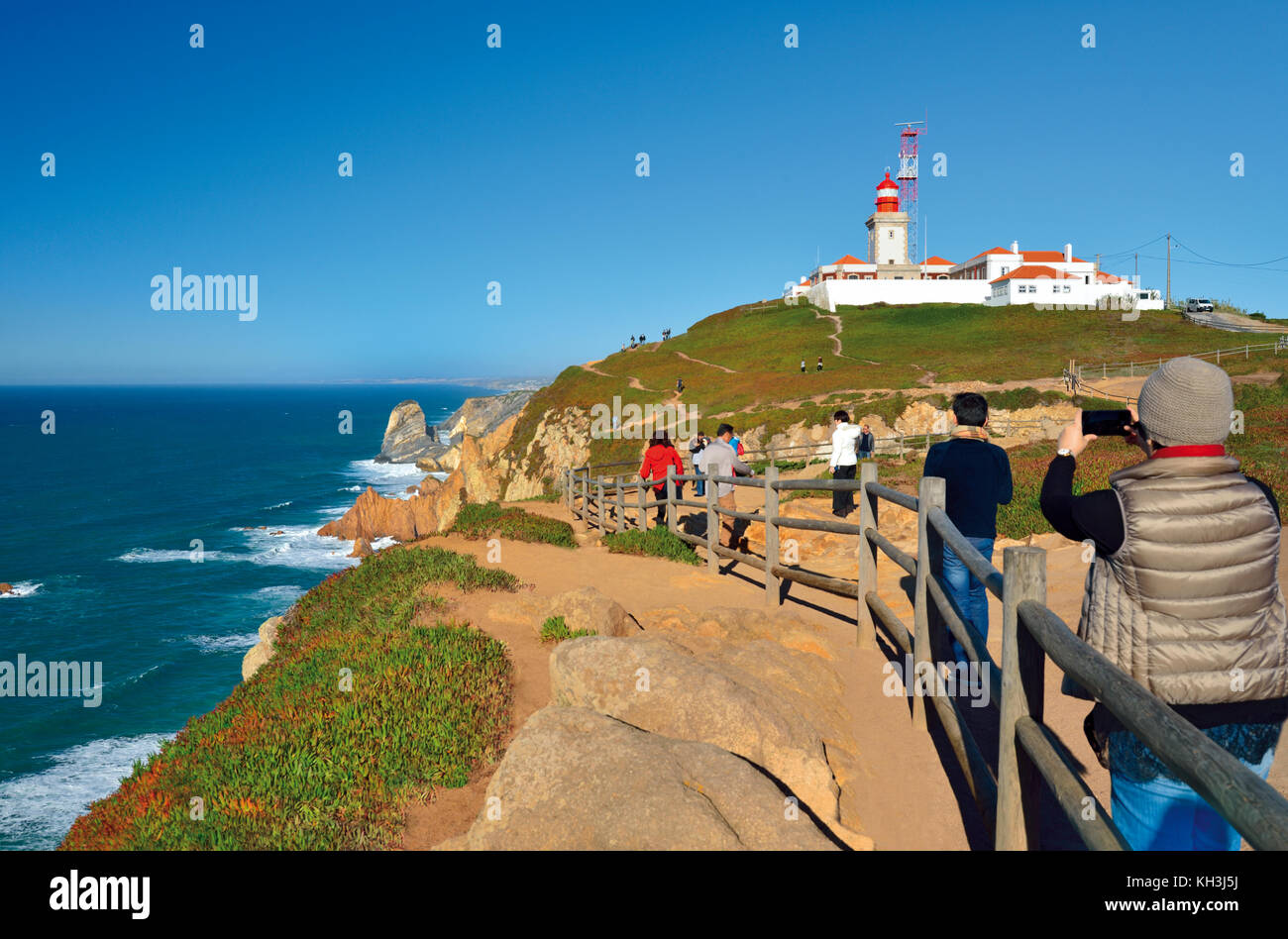 Tourists taking snapshot of Cabo da Roca, the most western point of continental Europe - Stock Image
