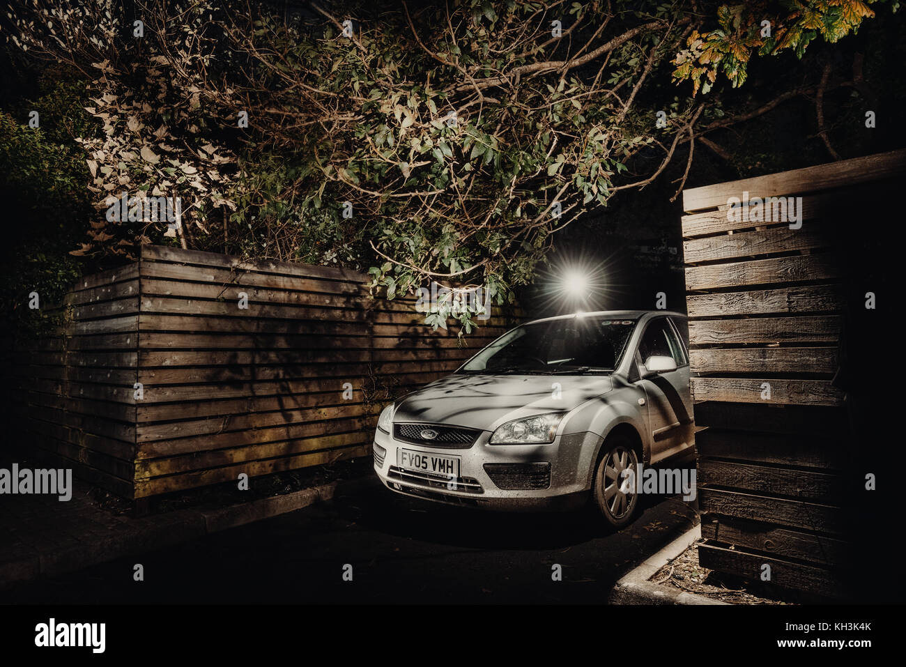 Silver Ford Focus parked outside at night, Cornwall - Stock Image