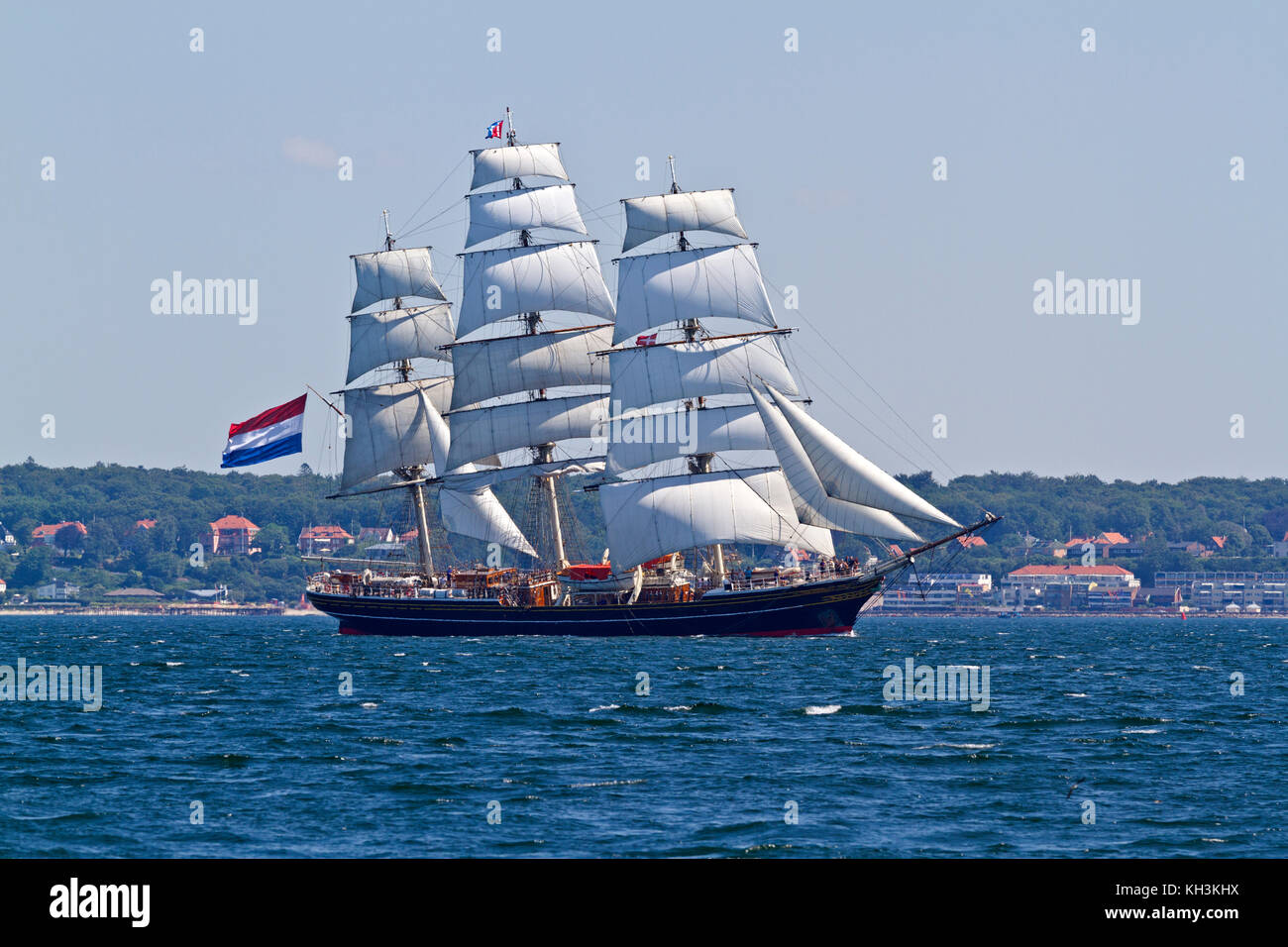 Stad Amsterdam, a Dutch three-masted clipper passing Kronborg at Elsinore in the Sound, Øresund, between Denmark - Stock Image