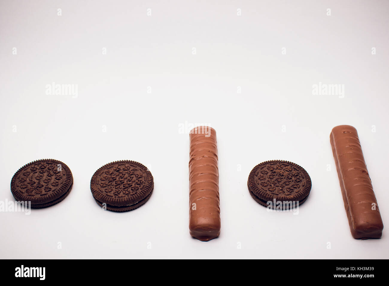 Caramel Chocolate Bar On White Background binary system quantum - Stock Image