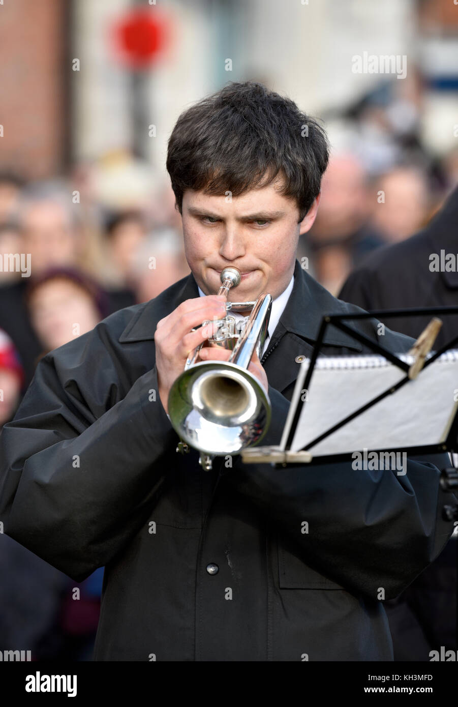 A bugler sounding The Last Post during Remembrance Sunday, War Memorial, High Street, Haslemere, Surrey, UK. Sunday - Stock Image