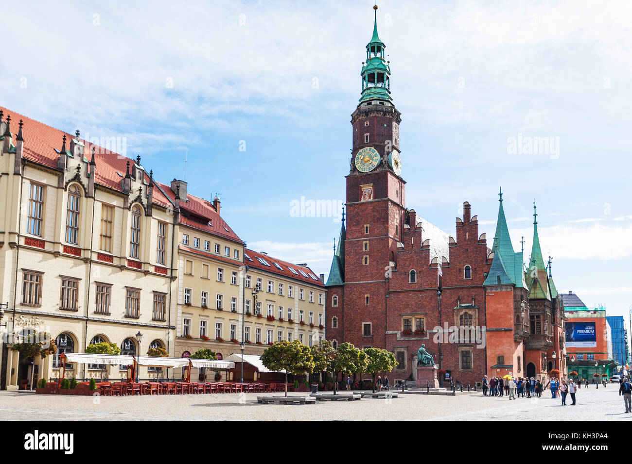 WROCLAW, POLAND - SEPTEMBER 12, 2017: tourist near tower of City Hall on central Market Square (Rynek) in Wroclaw. Stock Photo