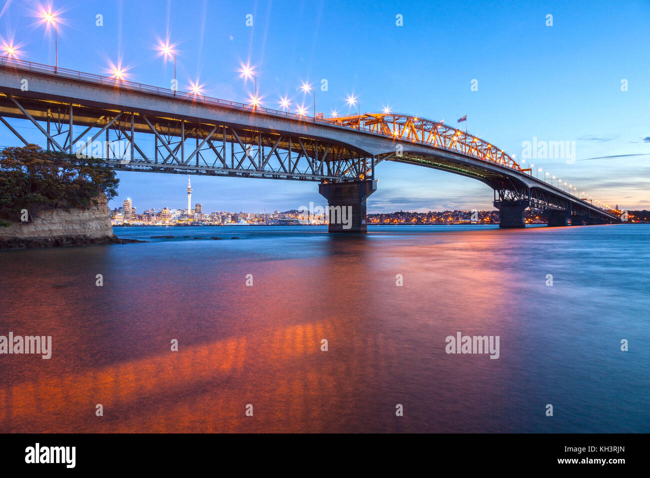 Auckland Harbour Bridge at twilight from Northcote Point. - Stock Image