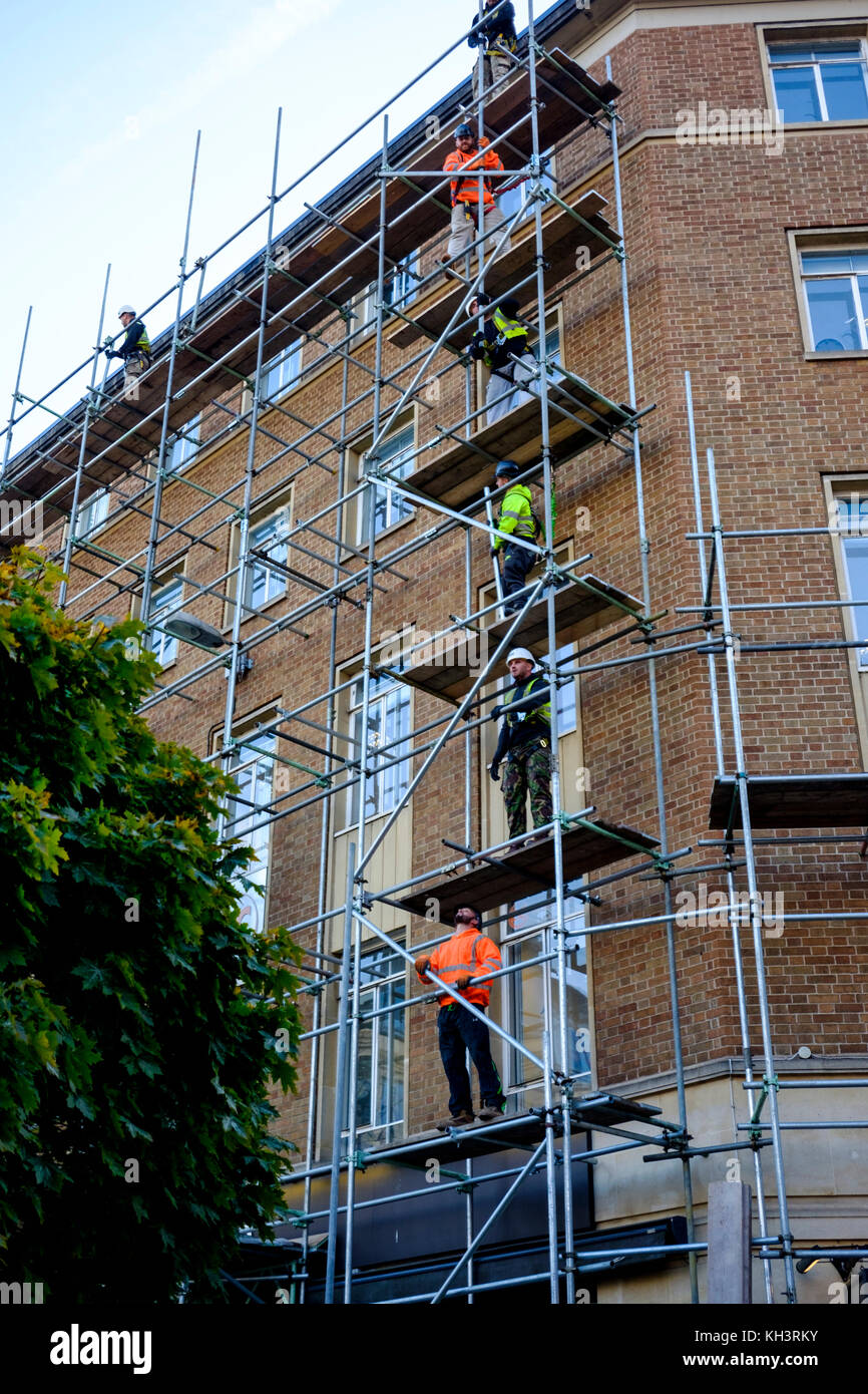 Scaffolders working on a building in Bristol - Stock Image