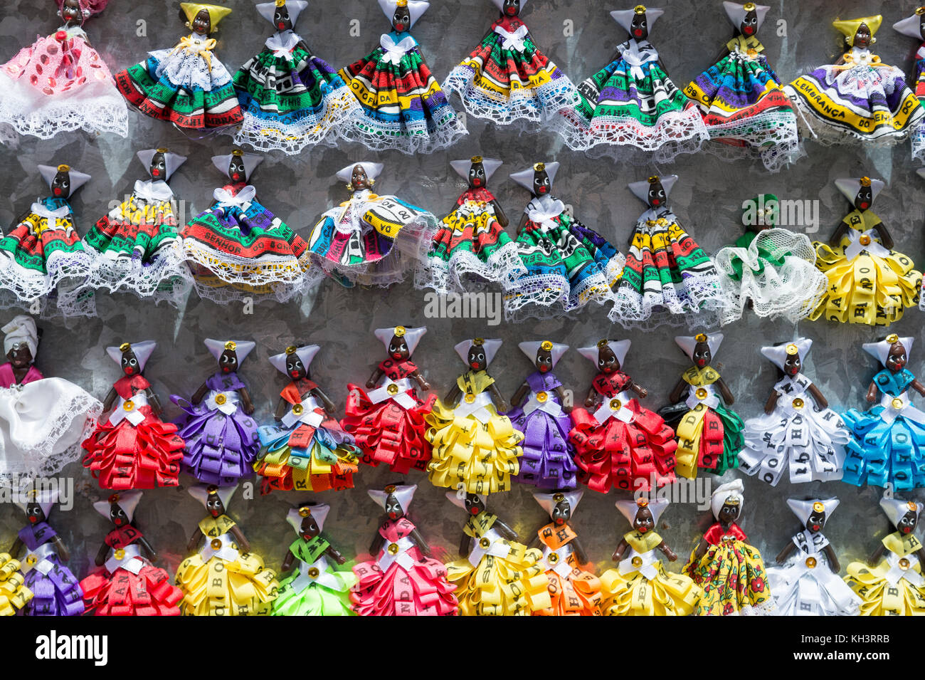 Colorful, souvenir, fridge magnet figurines of women from bahia in traditional dress on display Salvador, Bahia, - Stock Image