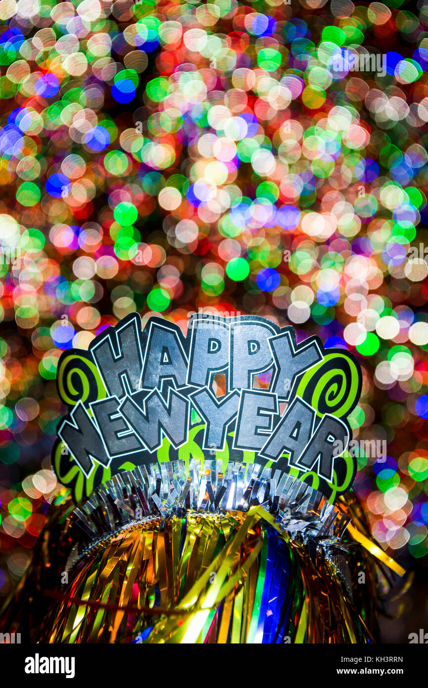 happy new year party hat sparkling against a glowing holiday celebration background in a colorful night
