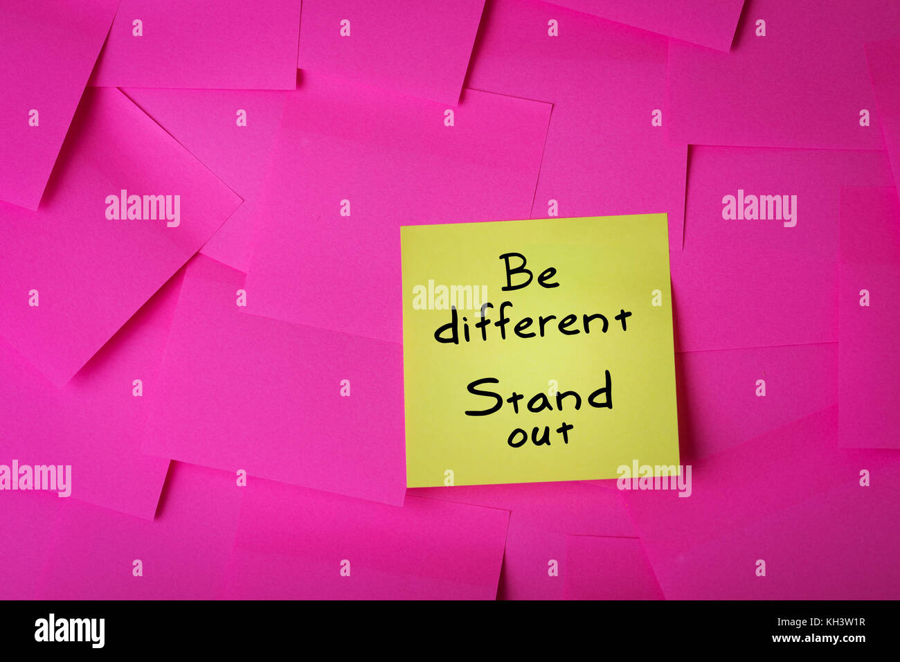 be different stand out text on yellow sticky note - Stock Image