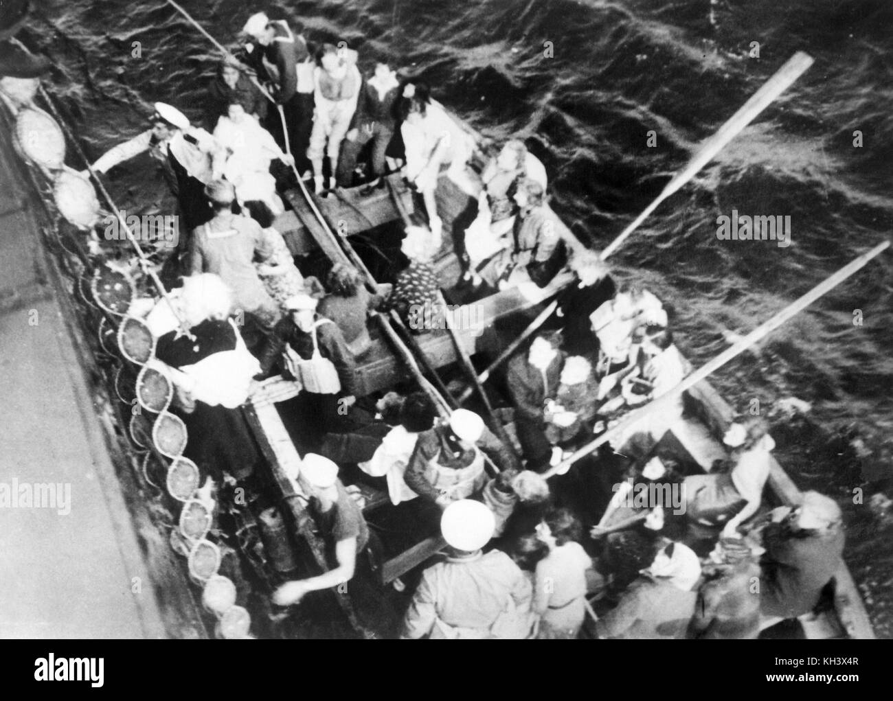 Survivors in one of SS Athenia's lifeboats alongside American cargo steamship City of Flint - Stock Image