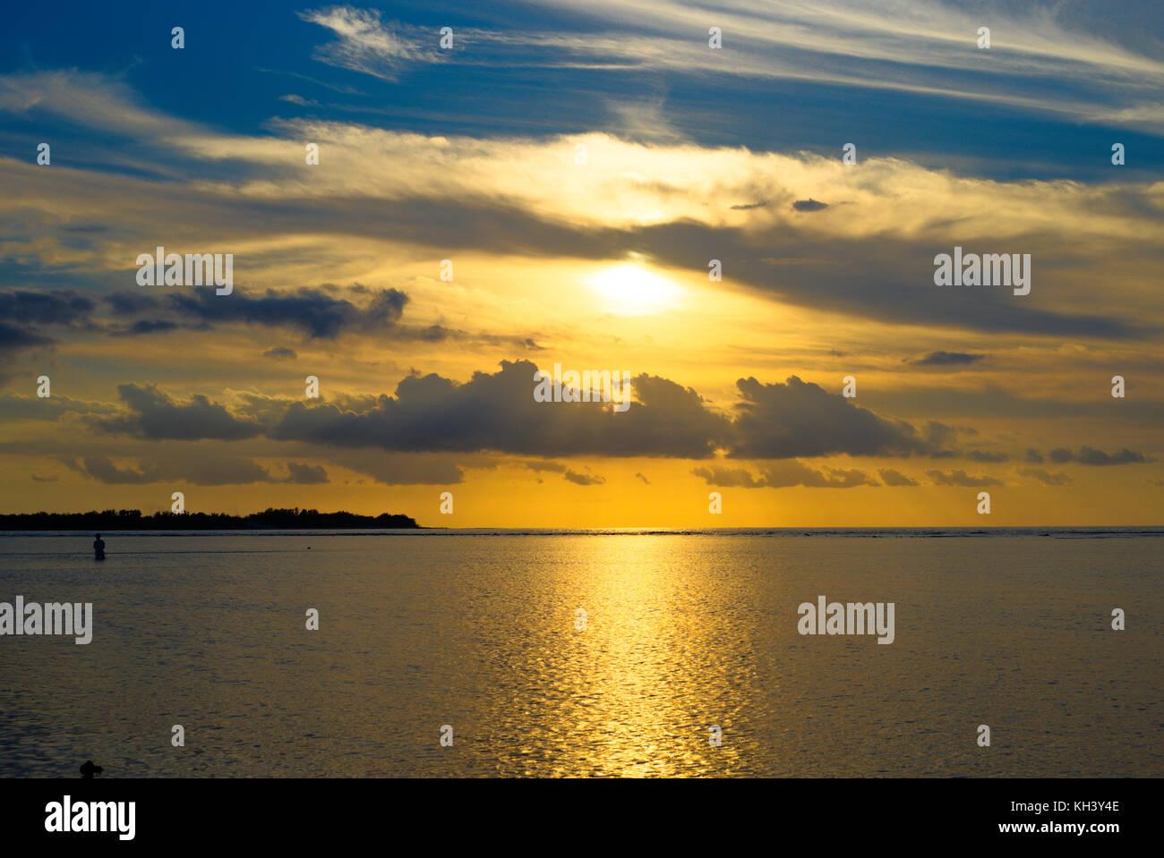 Sunrise Sunset Gili Air ocean sky clouds Gilis Indonesia Stock Photo