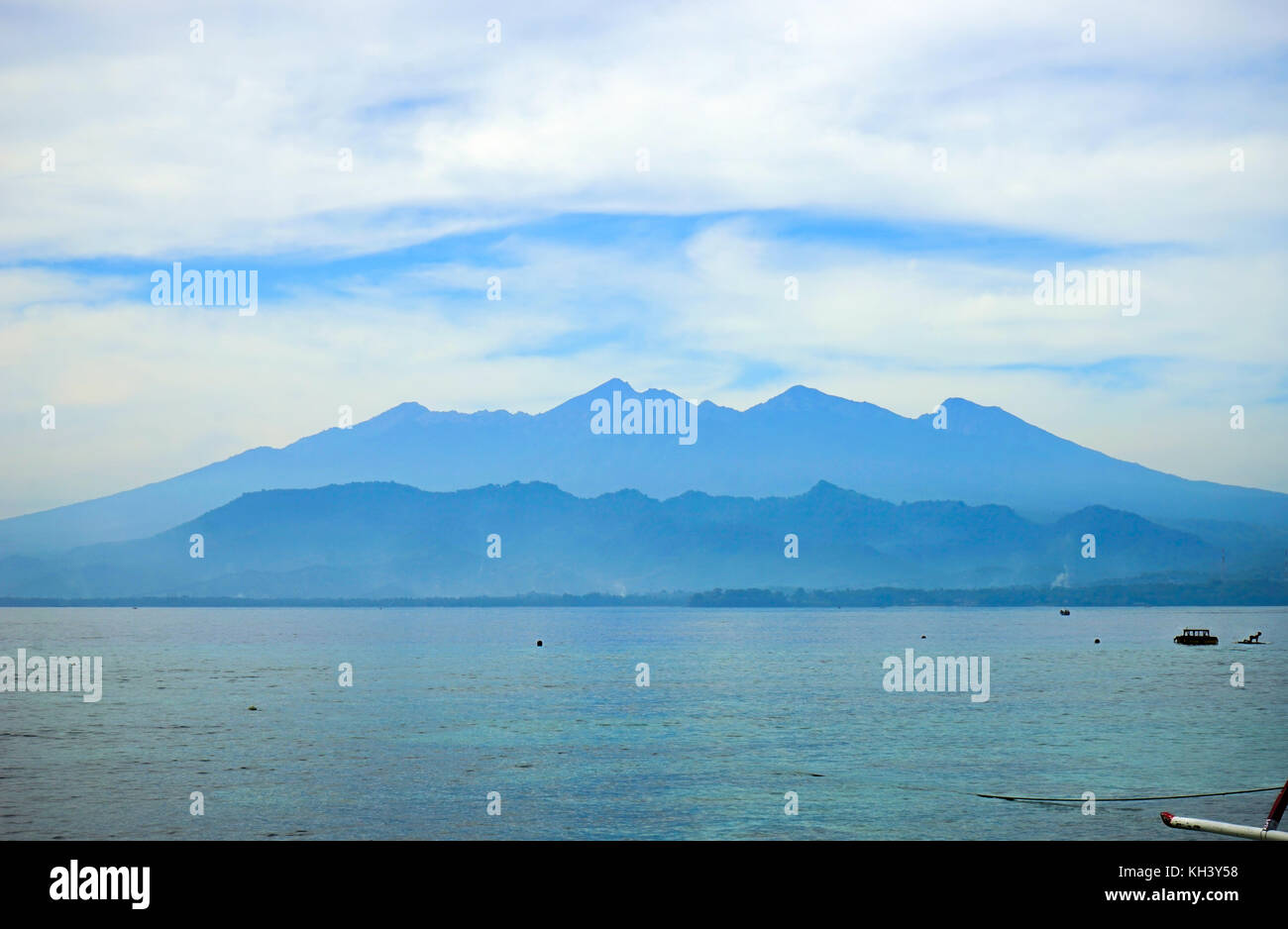 Gili Air view mountains ocean sky clouds Gilis Indonesia Stock Photo