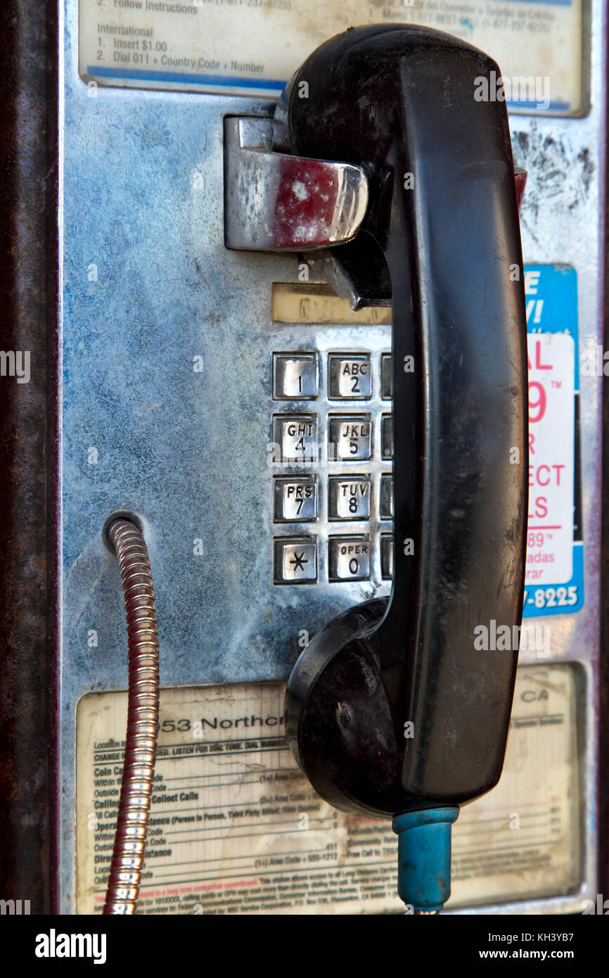Abandoned 'Classic' coin operated public telephone, California, United States. - Stock Image