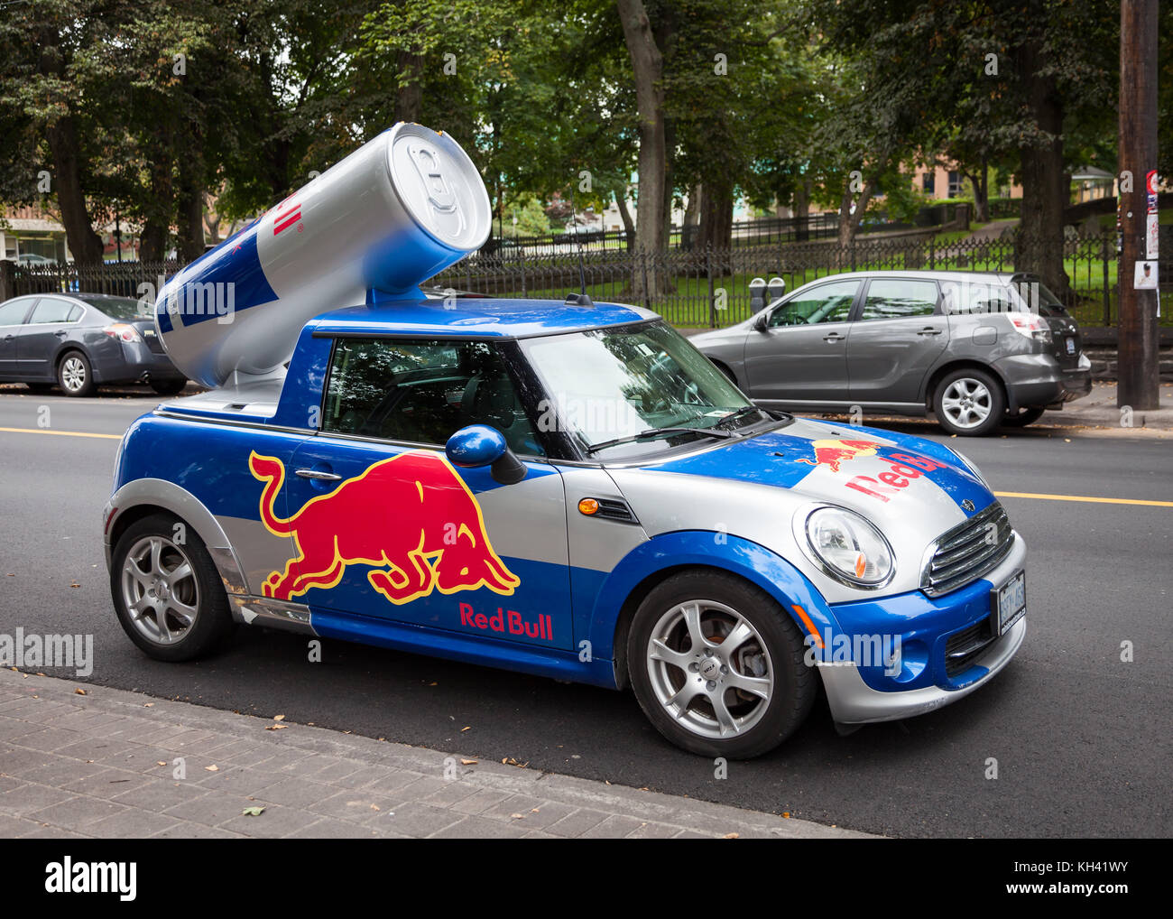 A Red Bull Mini Cooper Publicity Car With A Can Of Red Bull Drink In