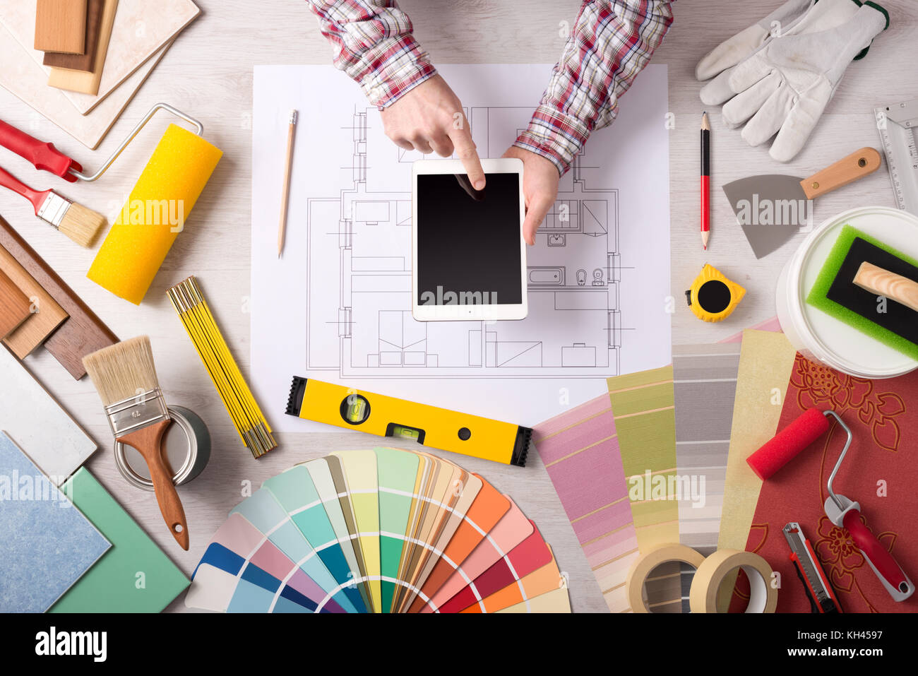 Professional Decorator Using A Digital Tablet Work Tools Painting