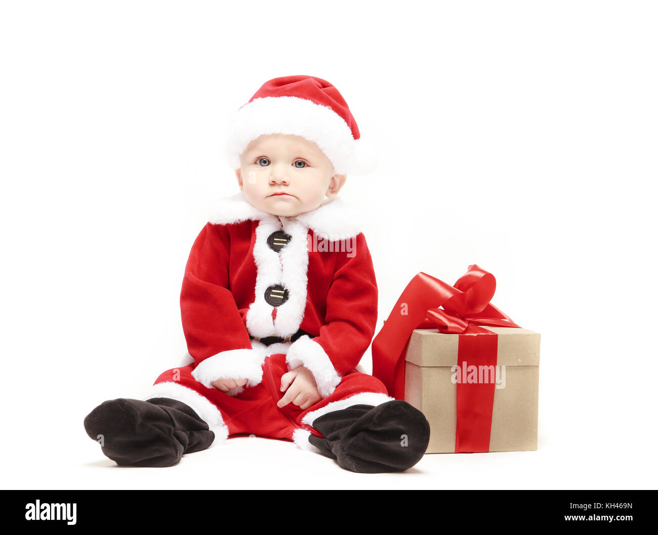 d0e32de216d Santa Claus baby in red christmas clothes with gift box isolated on white -  Stock Image
