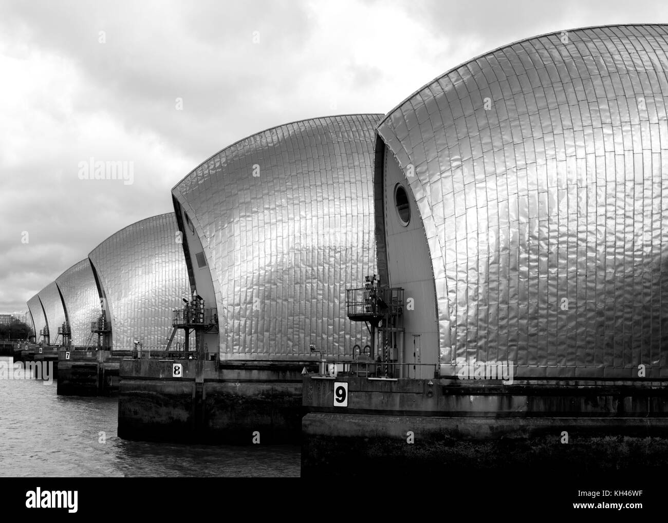 Black and white side view of The Thames Barrier, London, UK - Stock Image