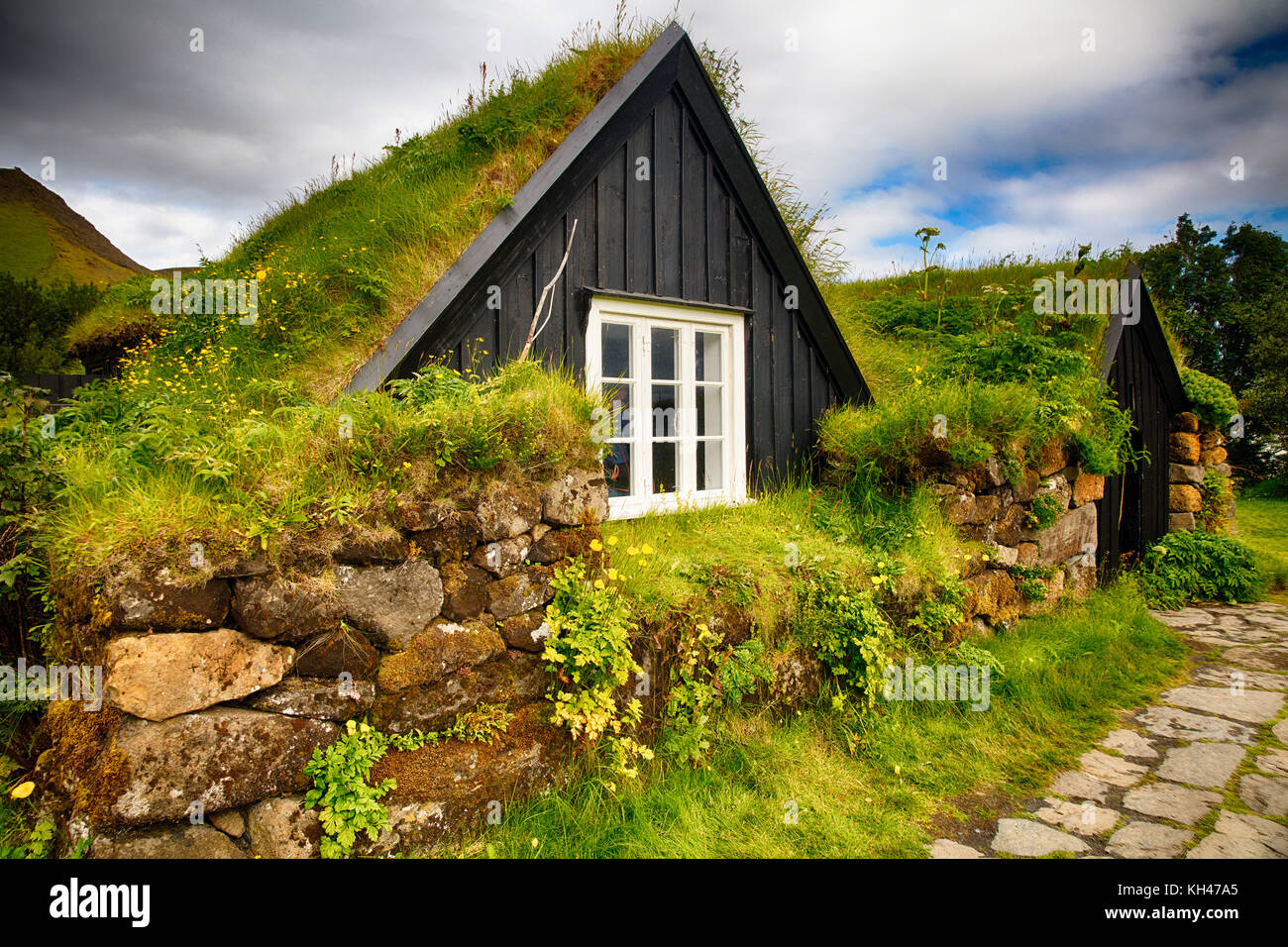 IcelandicTurfhouse During Summer, Skogar Folks Museum, Iceland - Stock Image