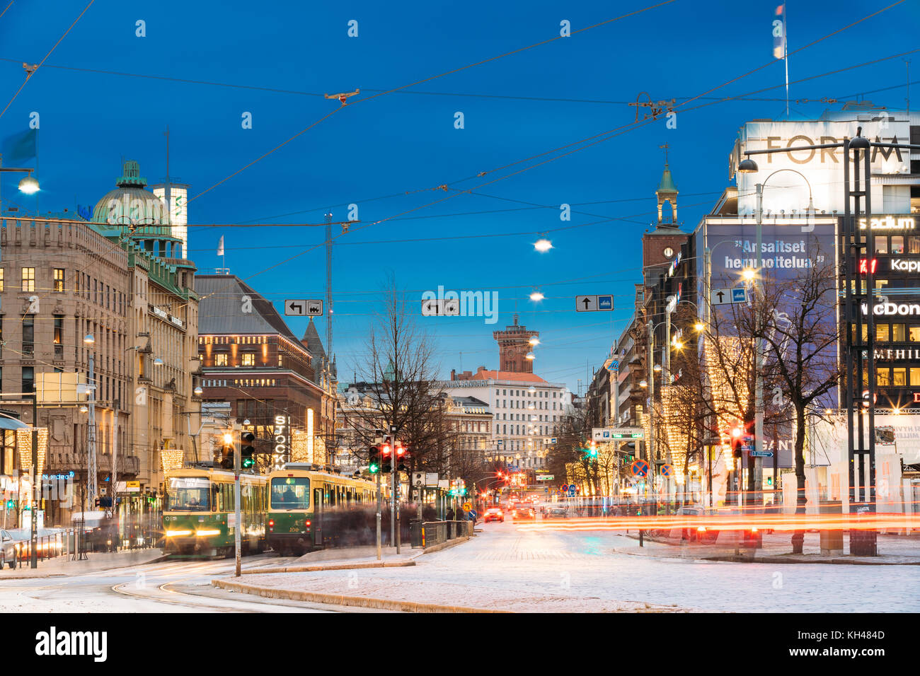 Helsinki, Finland - December 7, 2016: Tram Departs From A Stop On Mannerheim Avenue In Helsinki. Night View Of Mannerheim - Stock Image