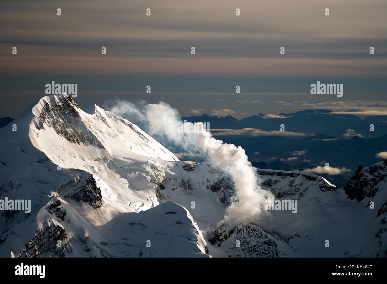 Mount Redoubt and Redoubt Volcano has an elevation of 10,197 feet above sea level.  Its located in Lake Clark National - Stock Image