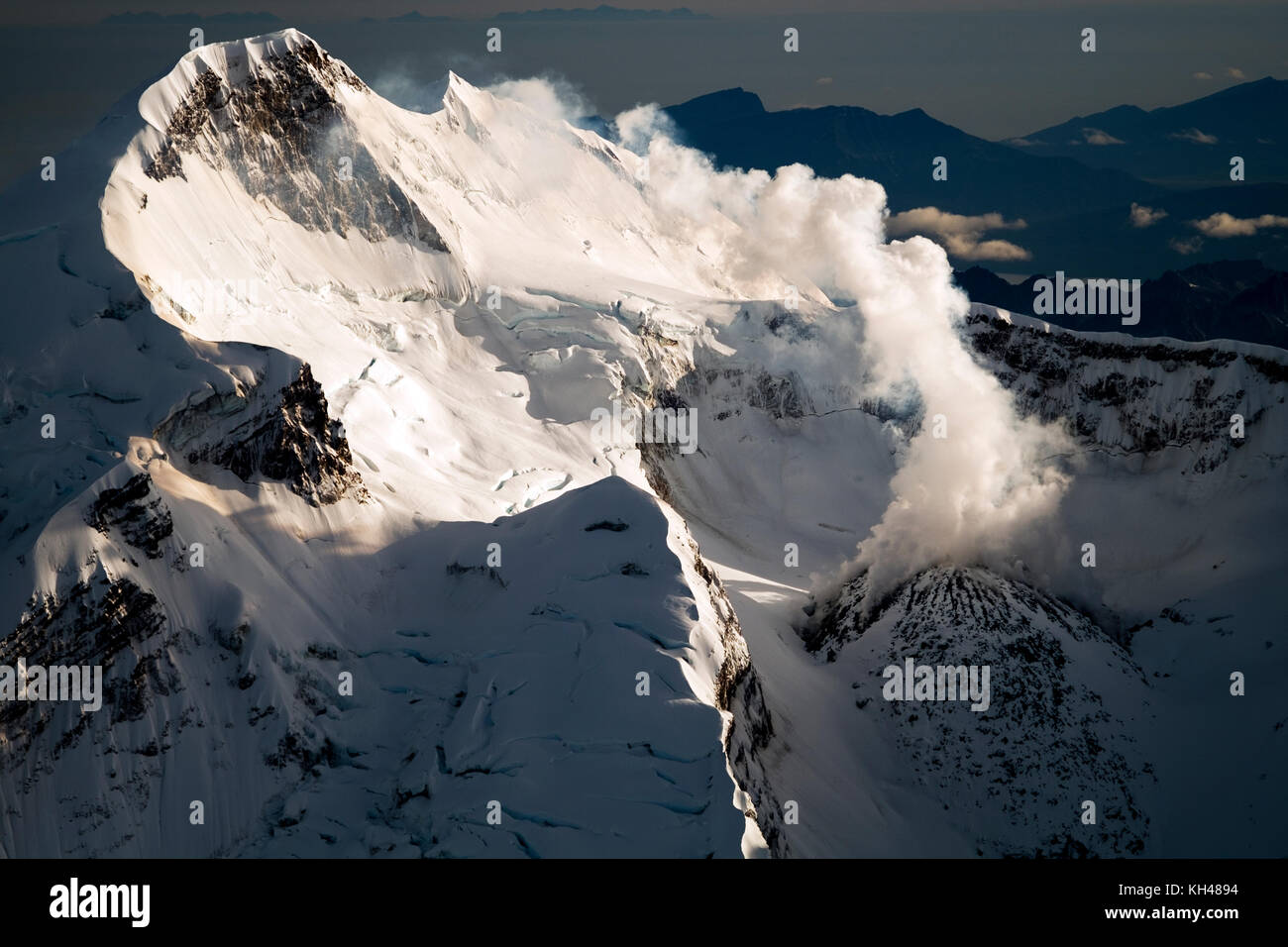Mount Redoubt and Redoubt Volcano has an elevation of 10,197 feet above sea level.  Its located in Lake Clark National Stock Photo