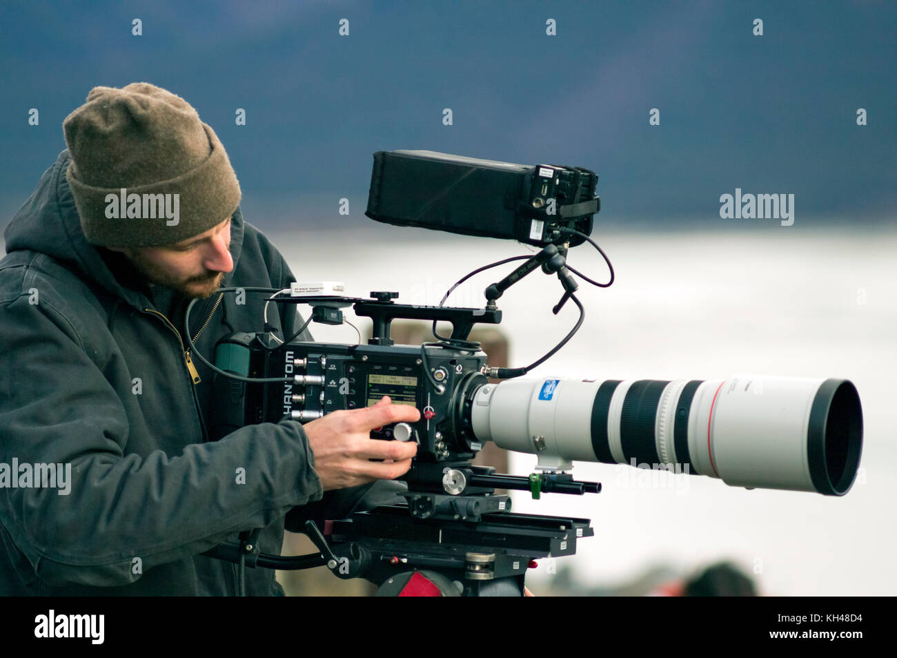 Nick operating the high speed Phantom Flex 4K video camera with the Canon 200-400mm f4.0 zoom lens on a shoot in - Stock Image