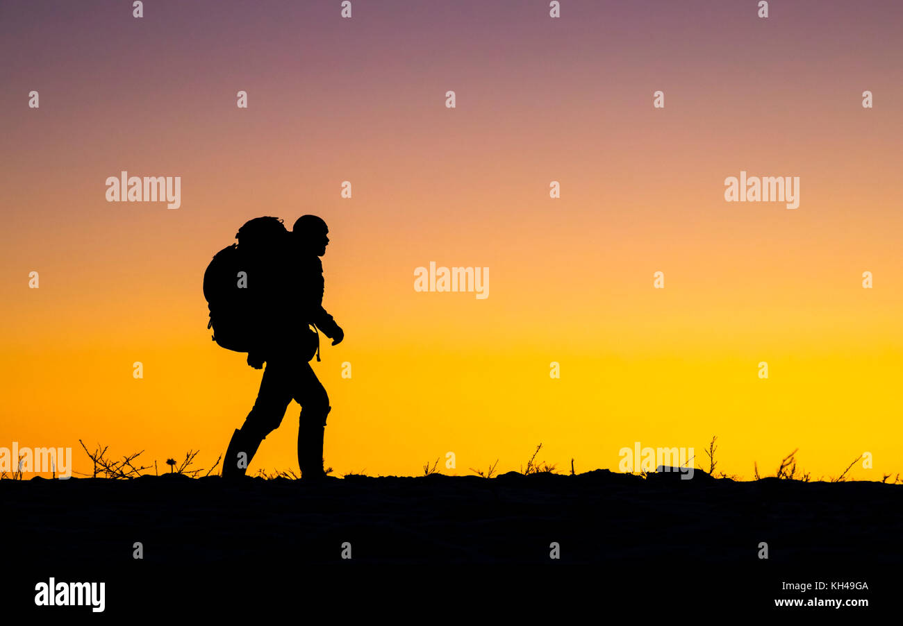 Hiking in the sunset - Stock Image
