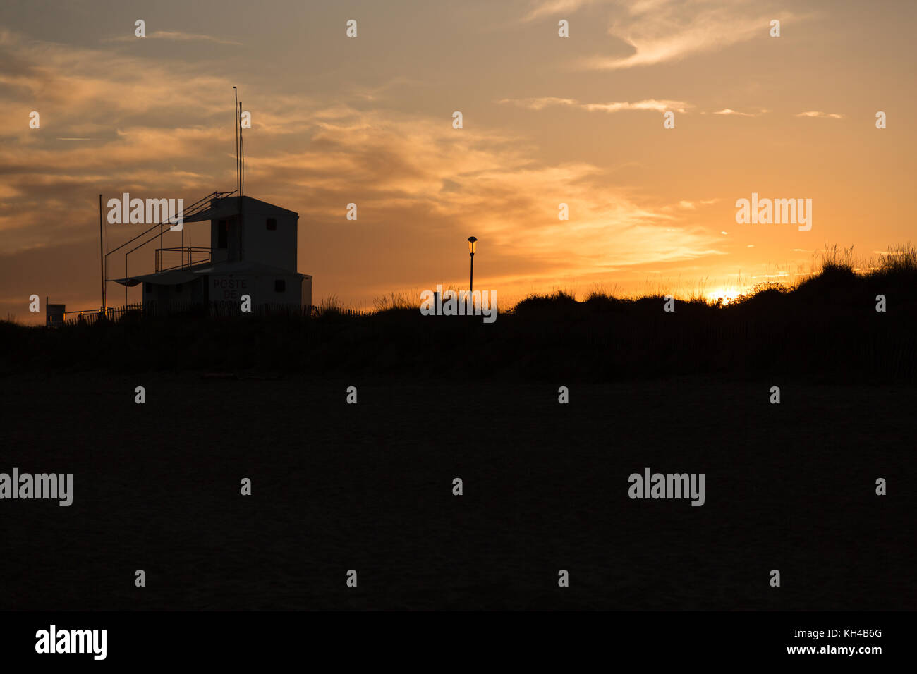 silhouette of the bay watch building during sunset - Stock Image