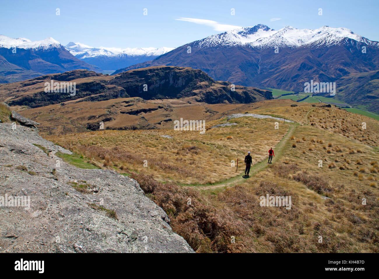 Hikers on Rocky Mountain, near Wanaka Stock Photo