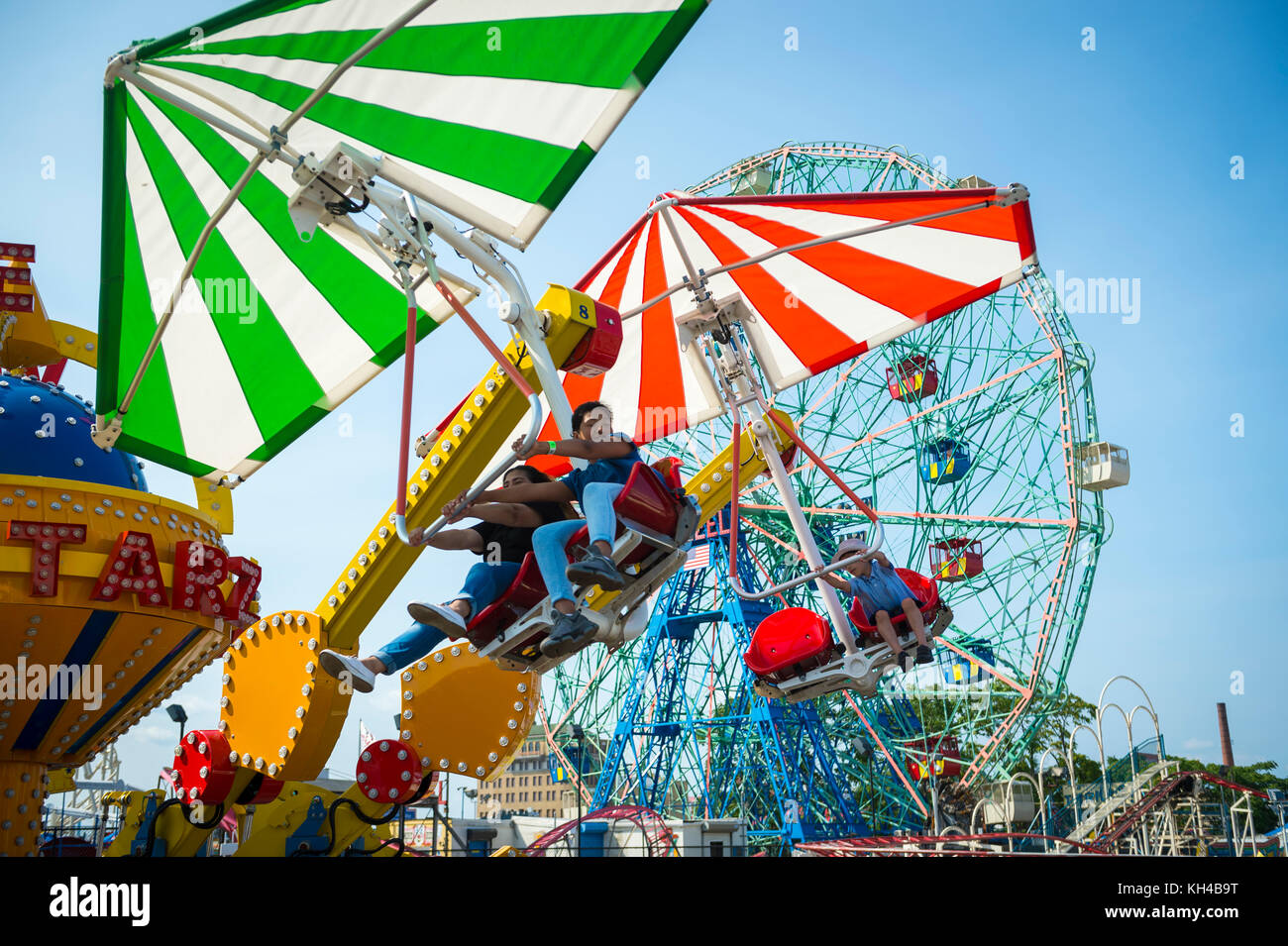 NEW YORK CITY - AUGUST 20, 2017: View of people enjoying a summer's day on crowded Coney Island boardwalk. - Stock Image