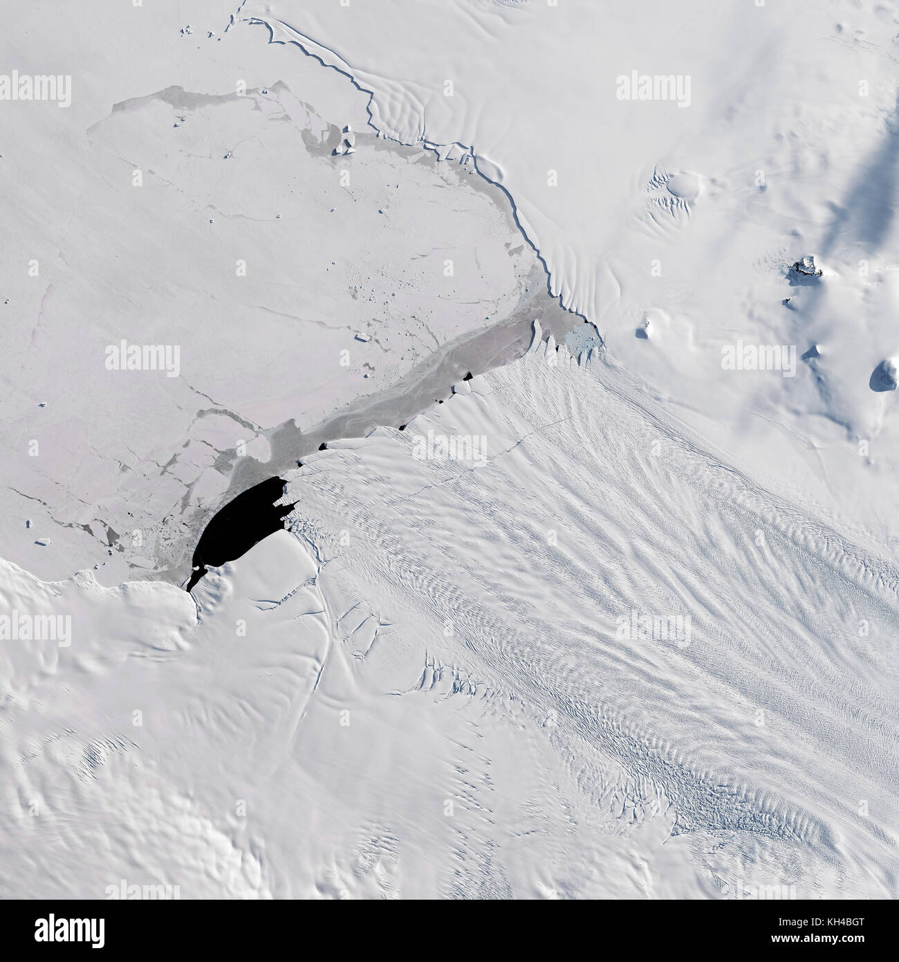A new iceberg calved from Pine Island Glacier—one of the main outlets where ice from the interior of the West Antarctic - Stock Image