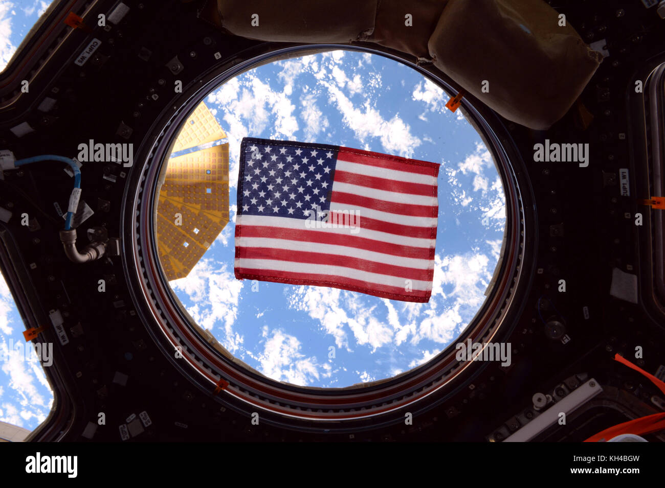 American Flag through window of International Space Station, by NASA - Stock Image