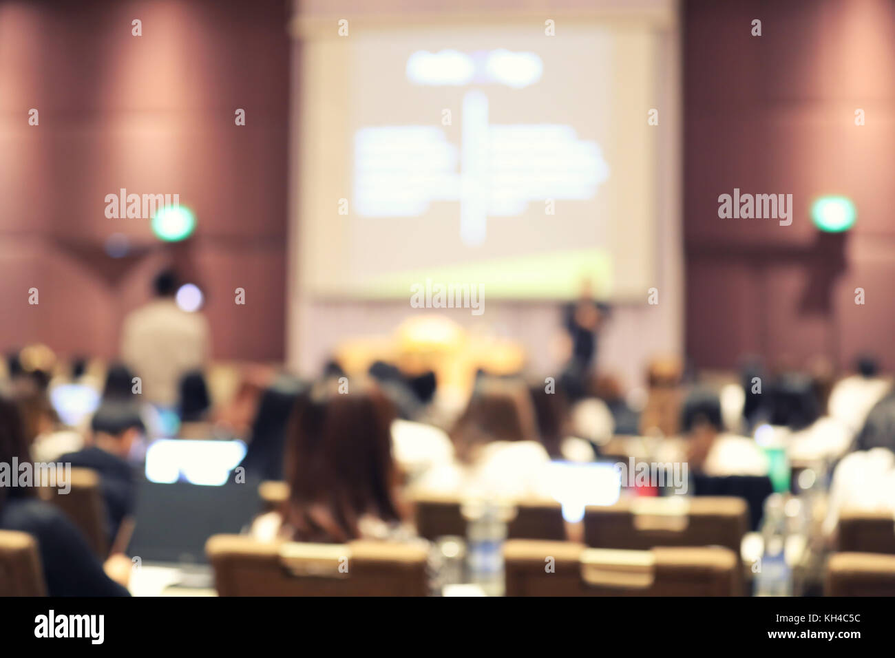 Abstract blurry background of employees seminar and De-focus teamwork staffs working meeting in conference room - Stock Image