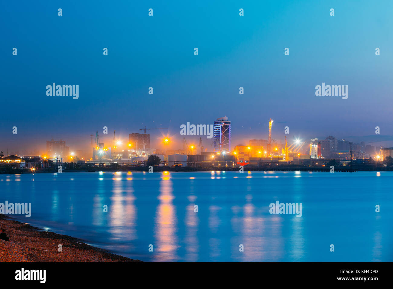 Batumi, Adjara, Georgia. Port Dock On Sunny Evening Or Night At Illuminations Lights. - Stock Image