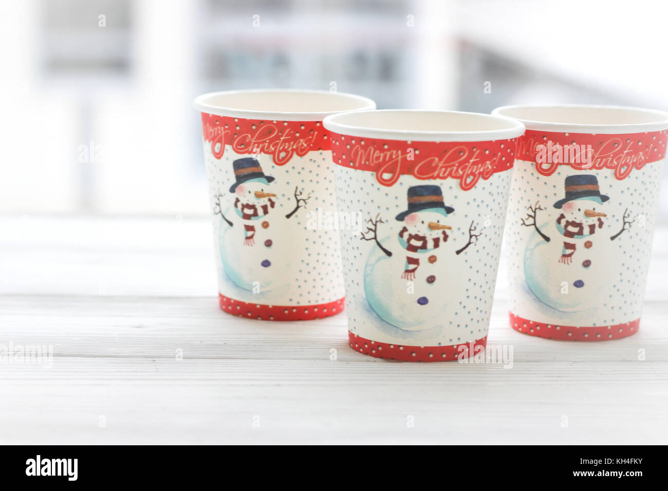Festive still life: three glasses with a picture of a snowman - Stock Image