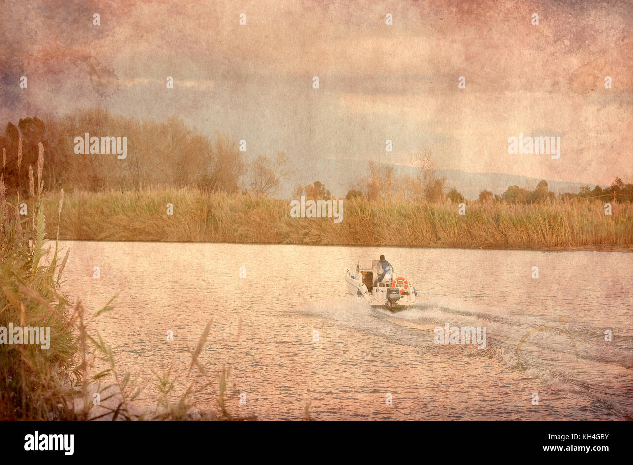 Motorboat moving on the river at sunset - texture - Stock Image