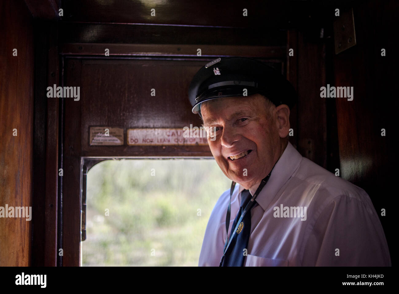 Guard on a train on the South Devon Railway - Stock Image