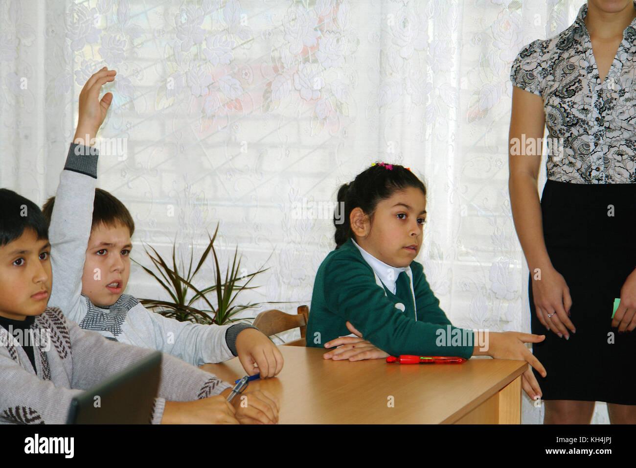 Schoolchildren in classroom - Stock Image