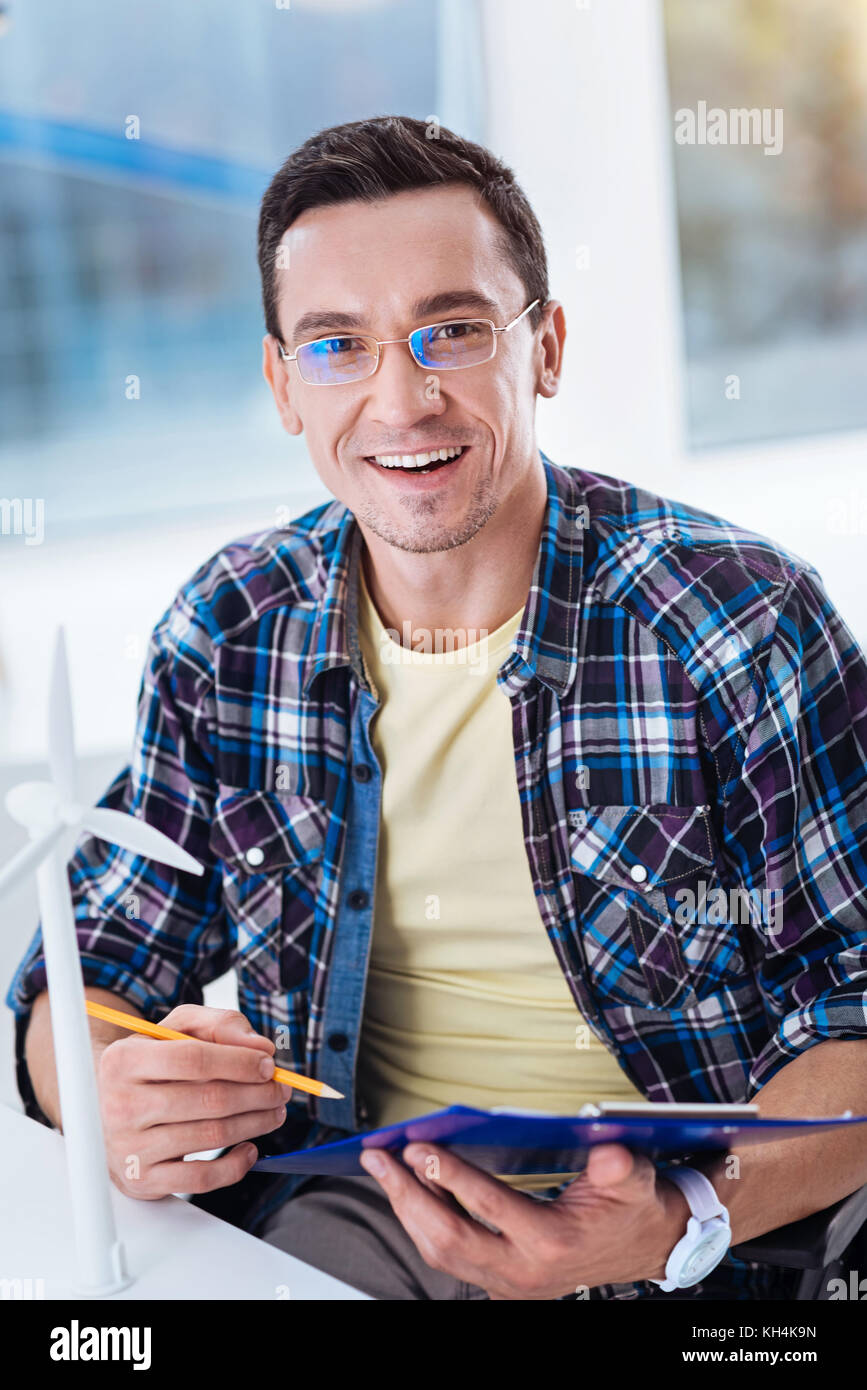 Portrait of handsome man that being at work - Stock Image