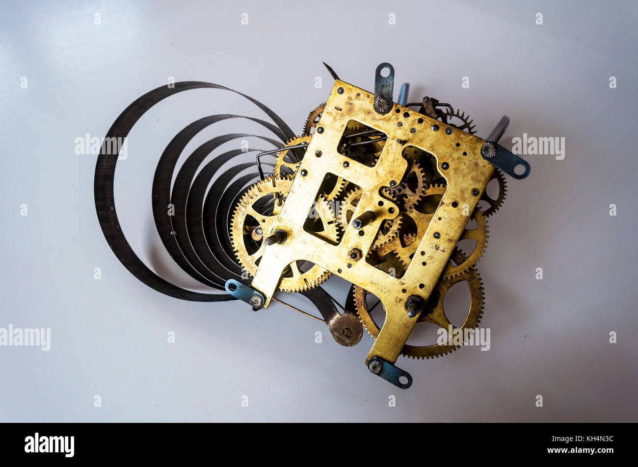 Tick-tock, the inner mechanism of a clock with a spring - Stock Image