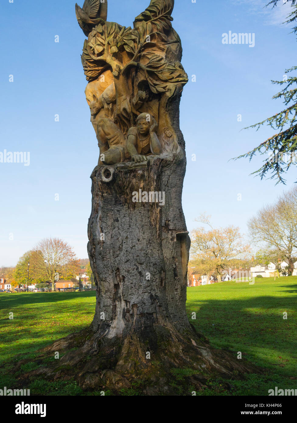 Leafing Through History beech trunk carving by Tom Harvey 2007 Abbey Gardens Pershore Worcestershire England UK - Stock Image
